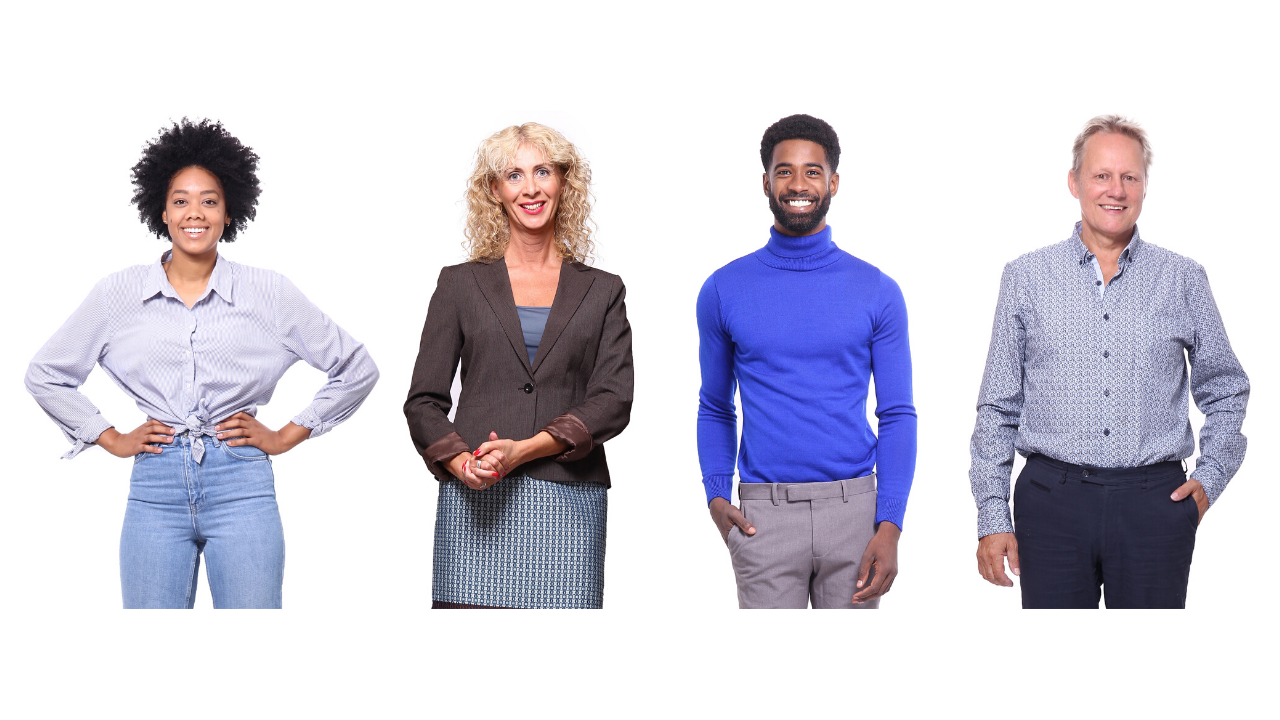Four people stand alongside one another. One Black female with short hair, a purple blouse and jeans with her hands on her hips. A white female with blonde curly shoulder-length hair is wearing a business suit and standing with her hands together to the side. A Black male with a bright blue turtleneck and gray pants stands with his hand in his pocket. A white male with short blonde hair is wearing a blue button up shirt and slacks and has his hand in his pocket. All are smiling and looking straight ahead.